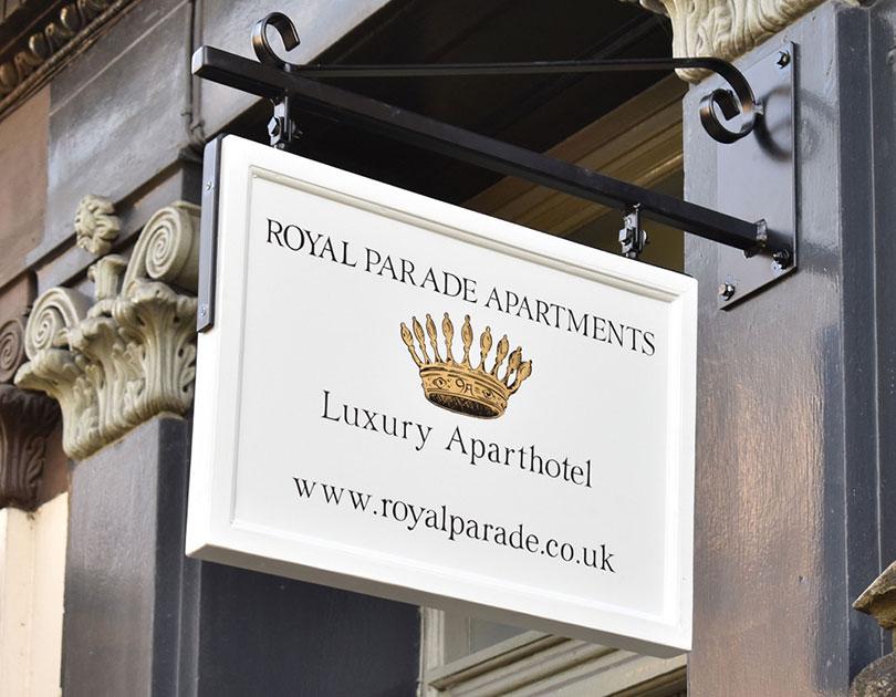 Royal Apartments Sign